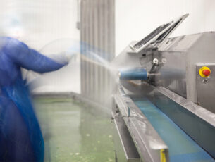 Cleaning a food processing machine